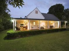 Weatherboard colonial house exterior with french doors & hedging - House Facade photo 494393