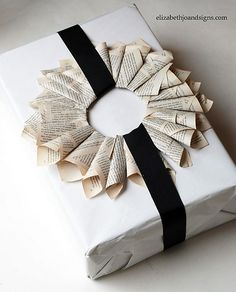 inspiration --- newspaper rosette rings gift wrap decoration ornament---could use twisted ring folded flat instead. Present Wrapping, Creative Gift Wrapping, Wrapping Ideas, White Wrapping Paper, Wrapping Paper Crafts, Wrapping Papers, Gift Wraping, Christmas Gift Wrapping, Book Gifts