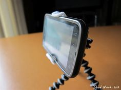 DIY Cell Phone Holder - For Your Car  http://davewirth.blogspot.com/2012/02/cell-phone-clip-car-holder.html  DIY – Cell phone clip for your car, made from a metal binder clip.  Works great, holds well and looks good too.  air vent, attach, binder clip, car, cell phone, cheap, clip, directions, diy, DIY Cell Phone Holder, easy, For Your Car, glue, hold, holder, lifehacker, phone clip, slip, wobble