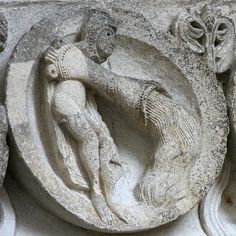 Autun Cathedral    Aquarius the Water-Carrier, zodiac sign for January. Detail of archivolt above the west portal of Autun Cathedral, sculpted by Gislebertus around 1130.