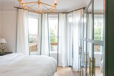 I'm ready to ditch the closet and go all out with a pax wardrobe now that I've seen how gorgeous paint, mirror inlays and brass hardware can make this Ikea classic. It takes this San Francisco bedroom to beautiful, bright