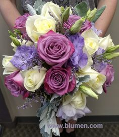 Bride's bouquet of lavender roses, lisianthus and limmonium, with white roses and hydrangea and grey dusty miller; www.blumen.com.