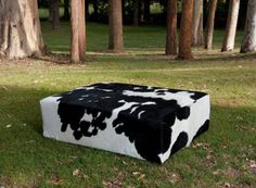 A modern black and white cowhide coffee table ottoman by Gorgeous Creatures who are a cowhide ottoman and leather decor specialists. www.gorgeouscreatures.co.nz or www.cowhideottoman.com.au