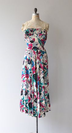 Vintage 1930s lightweight silk full length dress with bold floral print, strapless ruched bust, fitted bodice and waist, slight gathered drape at the back…