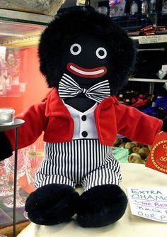 Mr Golliwog, one of my first toys. A black rag doll such as the red haired Raggedy Andy which was taken from children's story book characters. These dolls were beloved by many including myself.