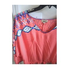 Tribal City Beautiful peachy colored top with drawing waist and tribal prints. Very light weight and chic. Wore with high waist jeans and fringe boots. It's a little too big for my liking. Would definitely fit an XL. ONE WORLD Tops Tunics