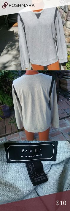 21 Men light sweat shirt Light long sleeve sweat shirt. Basic yet has statement, light gray with black lining around the shouldelrs and a small triangle right on the center. Pre own, no flaws Size: L 21 Men Shirts Tees - Long Sleeve