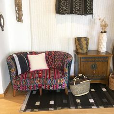 Our love seat at @shopmingei @mingeimuseum ! Perfect combination of guatemalan textiles and aftican mudcloth. Come by see it!
