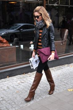 For easy style pair a leather jacket with striped high boots and oversized clutch http://rstyle.me/f6r6acbu6e