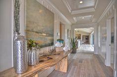 Wide hallways and rich millwork in Orange County. Details Design Firm.