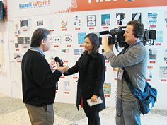 IDG World Expo VP/General Manager Paul Kent (left) speaks to a San Francisco TV crew on the opening day of Macworld|iWorld Expo.