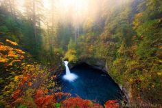 Beautiful waterfall enclasped by greenery