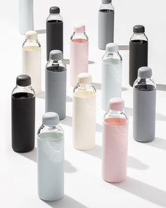 Upgrade everyday hydration with the Porter Bottle. Made from durable, lightweight glass and wrapped in protective matte silicone, this reusable water bottle is an eco-conscious and stylish replacement for disposable, plastic or metal canteens. Water Bottle Design, Glass Water Bottle, Glass Bottles, Drink Bottles, Bottle Bottle, Glass Drinking Bottles, Best Water Bottle, Swell Bottle, Bottled Water