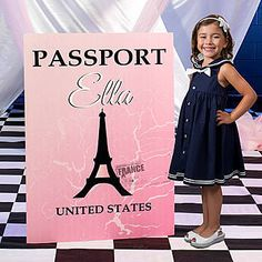 Our exclusive Pink Paris Passport Standee has the look of a passport book with an Eiffel Tower image on it. You will personalize the standee with your wording.