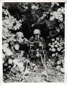 1941- German Soldiers in Camouflaged Position with Machine Gun