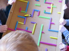 From maps to mazes by Teach Preschool - using a car to travel through a maze made out of milk shake straws.