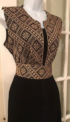 Long black Sleeveless Kimono / Vest / Jaket with Gold Palestinian Embroidery / corss stitch The belt is included in the price. The Kimono is also available in red embroidery Frock Fashion, Batik Fashion, Fashion Dresses, Batik Dress, Saree Dress, Kurta Designs Women, Blouse Designs, Modern Filipiniana Dress, Gala Dresses
