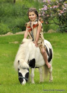 a girl and horse.