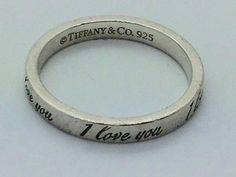 "Tiffany & Co Sterling Silver ""I Love You"" Ring  Sz 7 exc cond. Get the lowest price on Tiffany & Co Sterling Silver ""I Love You"" Ring  Sz 7 exc cond and other fabulous designer clothing and accessories! Shop Tradesy now"