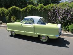 Our latest restoration. We took her out for a photo shoot with some pretty spring flowers! 1955 Nash Metropolitan