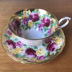 Tuscan Vintage Teacup and Saucer Sip your tea in style! This is a stunning vintage teacup and saucer by Tuscan China. This set has hand painted dark pink, light pink and bright yellow roses with small light and dark green leaves. The best thing about hand painted sets are seeing the brush