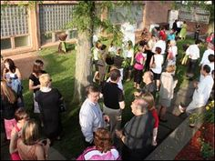 Guests enjoy the Death by Chocolate event in the TSA school garden.  (Toledo Blade, June 2010)