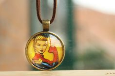 Handcrafted Captain Marvel necklace. Perfect for any Marvel / Avengers fan out there!  Made by hand from a Spider-Man comic book. I use all the pages from the book that I can and recycle the rest.  Do you have other fandoms you love? Feel free to browse my Etsy shop for jewelry pieces from Marvel, DC, Disney, Star Wars and Doctor Who!  Would you like a piece made with another favourite character? Send me a message. I would be more than happy to try and accommodate you!