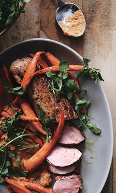 Romesco is to Spain what pesto is to Italy. It's typically made with red peppers, but we found sweet carrots work perfectly with this juicy roast pork tenderloin.