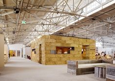Rael San Fratello Architects designs and builds a temporary gallery space out of straw bales and steel dividers as part of an art and design show in San Francisco.