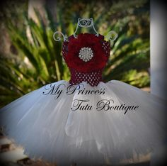 This ivory tutu dress is made with many yards of tulle tied to a very soft burgundy crochet bodice. This dress is super full. Colors for this particular wedding were ivory and burgundy but we can change the burgundy to a color of your choice. The matching headpiece for this dress is on the 2nd photo but is NOT included with this dress. If you would like to add the headpiece, please message me so that I can reserved a listing for you. ****Headpiece is NOT Included.****  Turn around is 6…
