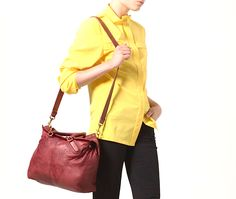 Un sac très soigné d'un très beau rouge bordeaux ! Cuir de vachette pleine fleur.