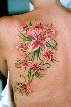 Feminine Shoulder Blade Tattoos | Lillies On Shoulder Blade - shoulder tattoo