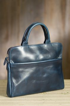 Beautifully crafted of Horween Cavalier leather, the Metropolitan is a smooth leather briefcase you'll be proud to carry.