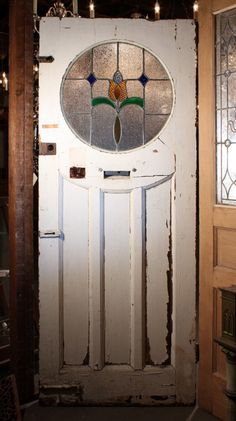 Antique Tudor Door with Round Stained Glass Window, Early For Sale… Antique Stained Glass Windows, Stained Glass Door, Glass Panel Door, Glass Front Door, Stained Glass Designs, Stained Glass Panels, Stained Glass Patterns, Leaded Glass, Mosaic Glass