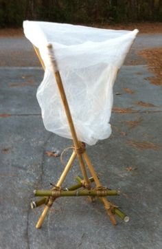 SELF-STANDING GARBAGE BAG HOLDER - Getting that garbage bag off the ground has all kinds of advantages, but sometimes, you can't hammer sticks into the ground to make the easy three stake holder.