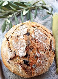 Panne all'Olive (Olive Bread)-Rustic Italian bread w/ olives: Jim Lahey recipe (but not photo): 3 c bread flour 1 1/2 c chopped olives 3/4 tsp active dry yeast 1 1/2 c cool (55 to 65 degrees F) water wheat bran, cornmeal, or flour for dusting Equipment: A 4 1/2 to 5 1/2-quart heavy pot. INSTRUCTIONS: http://www.splendidtable.org/recipes/panne-all-olive-olive-bread