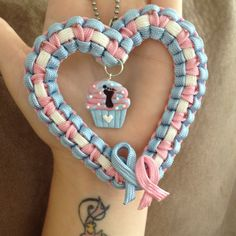 Paracord heart from Para-Knots (Facebook) and cupcake charm from Bits of Joy.
