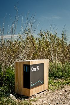 Signage incorporating natural elements