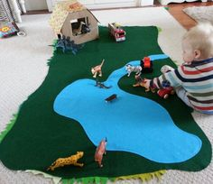 Love how this is so simple, and could be used for anything! Mini version for mini animals? Felt play mat with lake for dinosaurs/safari/farm animals using 3mm felt