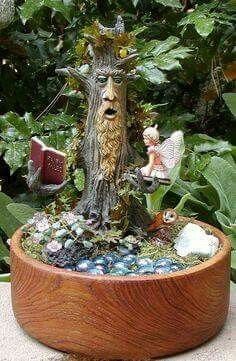 Grandfather tree reading to a fairy