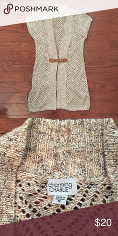 Charming Charlie knitted vest Charming Charlie knitted vest with faux leather buckle. Size small. Jackets & Coats Vests