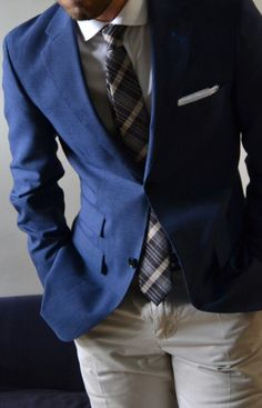 Blue blazer and khakis pants with a blue plaid tie