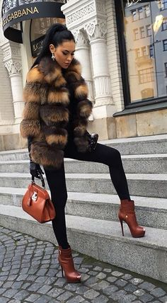 Fox fur coat: Olesya Malinskaya. real fur is knows as an luxury item but how is that luxury in anyway!
