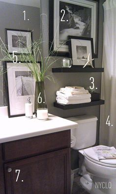 1. Paint walls w/ an existing neutral color (grey)  2. Cover window with a picture 3. Floating shelves add storage + display 4. Window panels as shower curtains add height 5. Personal photos shot + framed 6. Details: greens - even faux - give life to a space + scented candle keep space smelling fresh. 7. Add door knobs to cabinet