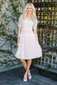 Sloan Who doesn't love an absolutely beautiful lace dress! This stunning white lace dress features a pretty nude lining, half sleeves, a round neckline and princess seams. Grad Dresses Short, Bridesmaid Dresses With Sleeves, Dresses For Teens, Church Dresses, Dresses Dresses, Church Clothes, Wedding Dresses, Modest Skirts, Modest Outfits