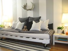 Love the gray stripped walls and couch/bed made out of an old pallet