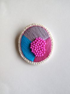Colorful geometric brooch embroidered bright blue and violet with lavender and violet beads