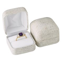 Natural Linen Ring Gift Box Natural linen fabric covers this metal-frame box. Interior is white velvet; lid is lined with white satin. Delivered in a two-piece packer.