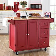 Kitchen island...in red. Wheels, wood top and flip-up breakfast bar. Sounds perfect.