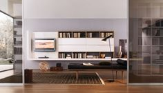 20 Contemporary Living Area Wall Units for Book Storage from Misuraemme : 20 Modern Living Room Wall Units With White Wall Wooden Books Storage LED TV Cabinet Black Sofa Carpet Lamp Hardwood Floor Living Room Wall Designs, Living Room Wall Units, Living Room White, Living Room Storage, Beautiful Living Rooms, Living Area, Modern Wall Units, Living Room Modern, Home Living Room